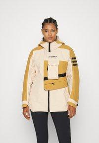 adidas Performance - TERREX XPLORIC RAIN - Hardshell jacket - halo blush/mesa - 0