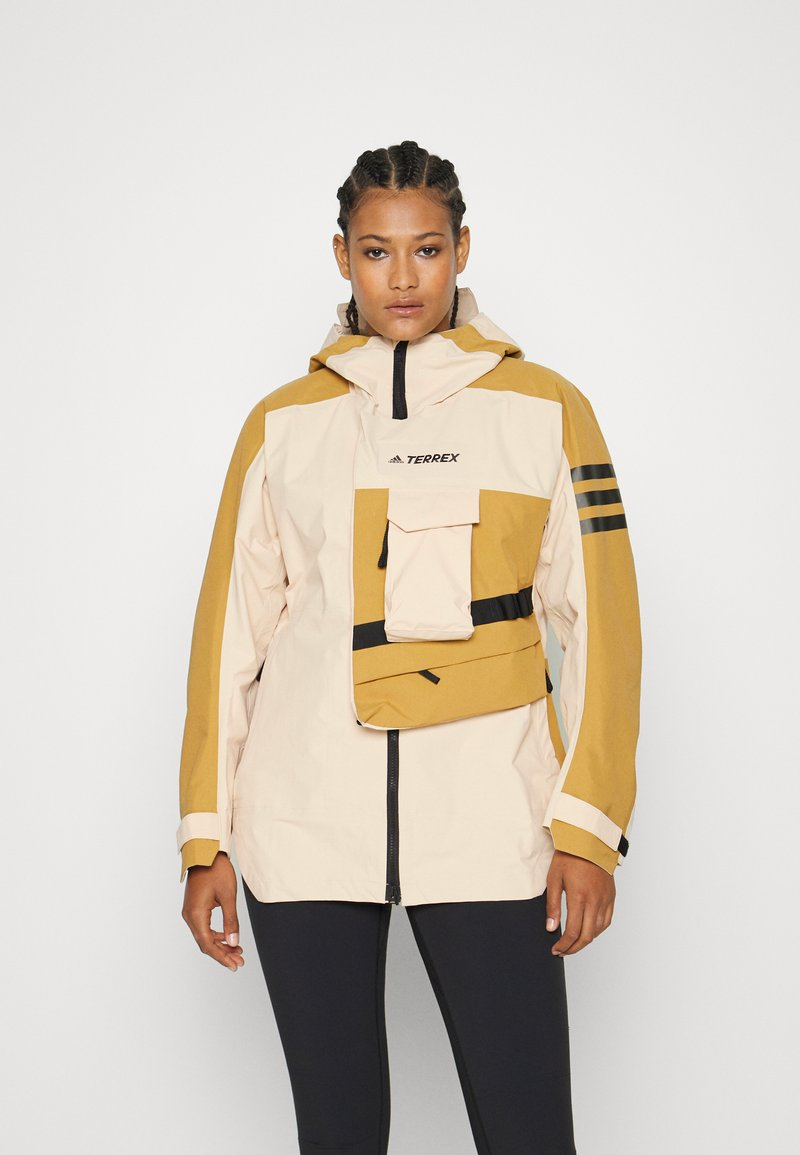 adidas Performance - TERREX XPLORIC RAIN - Hardshell jacket - halo blush/mesa