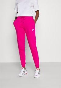 Nike Sportswear - Tracksuit bottoms - fireberry/white - 0