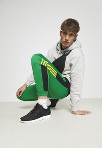 adidas Originals - CLASSICS  - Tracksuit bottoms - green/black - 1