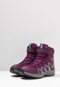 Salomon - XA PRO 3D WINTER TS CSWP - Winter boots - dark purple/potent purple/atlantis - 3