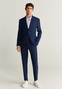 Mango - SLIM FIT ANZUGHOSE AUS WOLLSTOFF - Suit trousers - tintenblau - 1