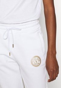 Versace Jeans Couture - PANTS - Tracksuit bottoms - white - 3