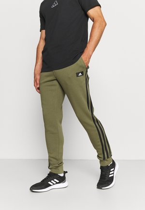 WINTER FUTURE ICONS - Tracksuit bottoms - focus olive