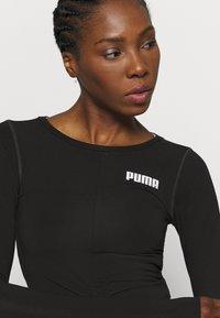 Puma - PAMELA REIF X PUMA COLLECTION RUSHING - Camiseta de deporte - puma black - 6