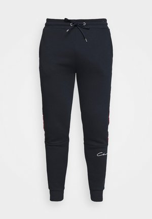 TAPED SCRIPT JOGGER - Tracksuit bottoms - navy