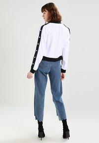 Urban Classics - LADIES BUTTON UP TRACK JACKET - Bomber Jacket - white/black/white - 2