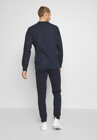Champion - CUFF PANTS - Verryttelyhousut - dark blue - 2