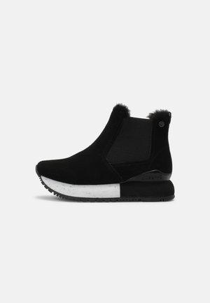 NORDEN - Winter boots - black