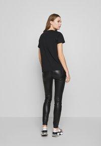 KARL LAGERFELD - COATED - Jeans Skinny Fit - black - 2