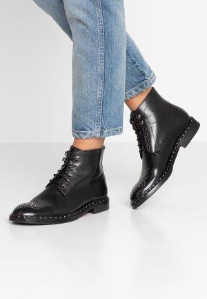 SALLY - Kotníková obuv - black