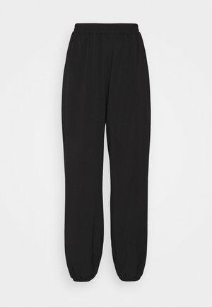 NA-KD X ZALANDO EXCLUSIVE - SPORTY FABRIC PANTS - Teplákové kalhoty - black