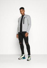 Nike Sportswear - Träningsjacka - grey heather/black - 1