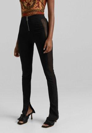 TÜLL IM KONTRAST - Spodnie materiałowe - black