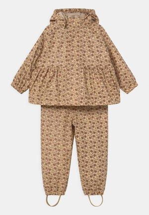 PALME RAINWEAR GIRL SET - Pantalones impermeables - tan