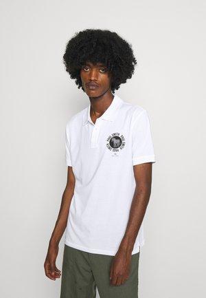 EXCLUSIVE ZEBRA PRINT - Polo shirt - white