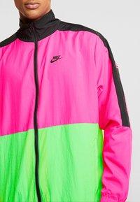 Nike Sportswear - Träningsjacka - black/hyper pink/scream green - 7