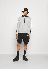 Nike Sportswear - Huppari - grey heather/black - 1