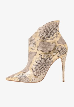 LUGENSA - High heeled ankle boots - gold