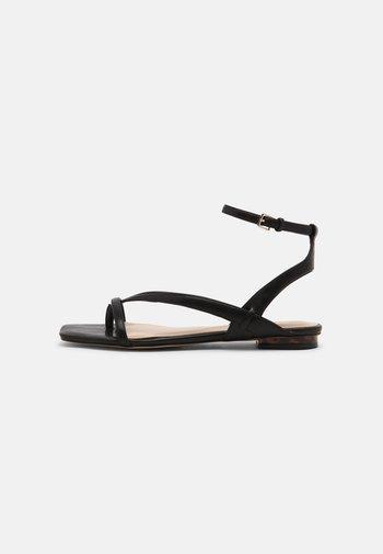 RHIGONI - Sandals - black