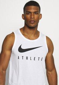 Nike Performance - TANK ATHLETE - Camiseta de deporte - white/black - 4
