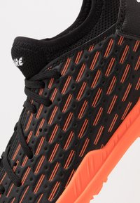 Puma - FUTURE 6.4 TT - Astro turf trainers - black/white/orange - 5