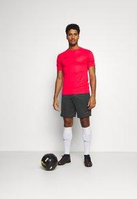 Nike Performance - SHORT - Sports shorts - black/siren red - 1