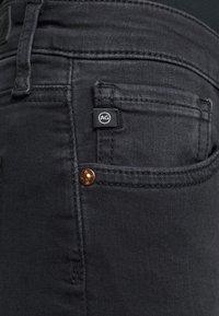 AG Jeans - THE MARI SLIM STRAIGHT - Slim fit jeans - black denim - 4
