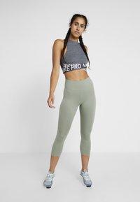 Nike Performance - NIKE ONE TIGHT CAPRI - Leggings - jade stone/black - 1