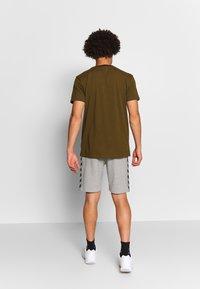 Hummel - HMLMOVE  - Sports shorts - grey melange - 2