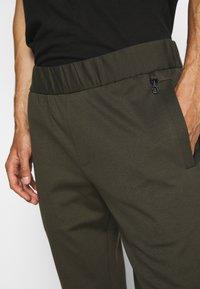 Emporio Armani - JEZZ - Trousers - dark green - 3