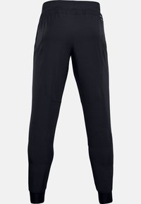Under Armour - UNSTOPPABLE JOGGERS - Joggebukse - black - 1