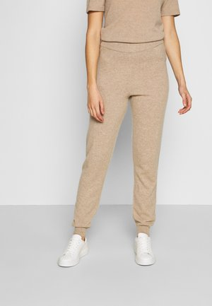 EWANDA - Tracksuit bottoms - light camel melange