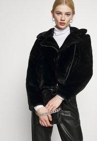 Vero Moda - VMTHEA BIKER JACKET - Winter jacket - black - 3