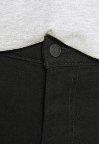 Hollister Co. - CLEAN  - Denim shorts - black - 5
