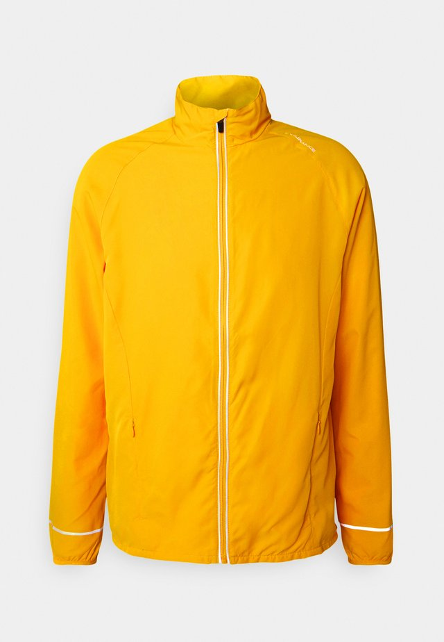 LESSEND JACKET - Hardloopjack - dark yellow