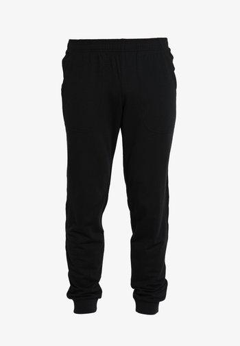 SHIFTER PANTS - Tracksuit bottoms - black