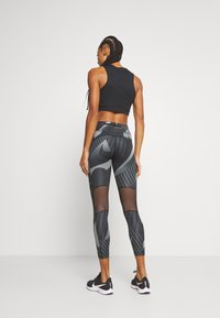 Nike Performance - FAST 7/8 RUNWAY - Leggings - black/black/reflective silver - 2