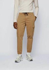BOSS - Cargo trousers - beige - 0
