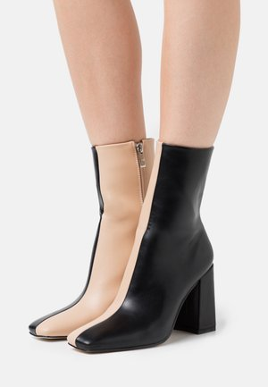 VANEZA - Classic ankle boots - black/nude