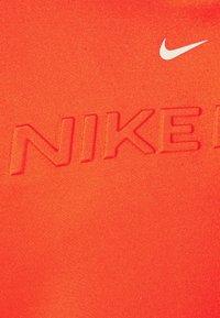 Nike Performance - HOODIE - Hoodie - chile red/metallic silver - 5