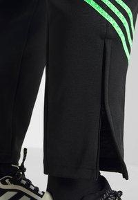adidas Originals - TRACK PANT UNISEX - Tracksuit bottoms - black/shock lime - 4