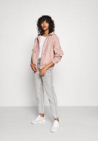 BDG Urban Outfitters - SKATE HOOD JACKET - Light jacket - pink - 1