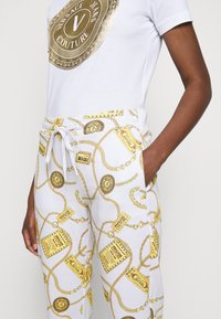 Versace Jeans Couture - Tracksuit bottoms - white - 4