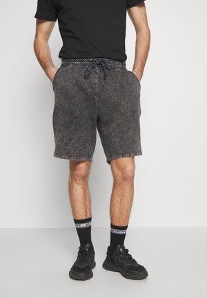 WAVE - Tracksuit bottoms - washed black