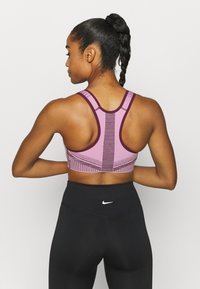 Nike Performance - FE/NOM FLYKNIT BRA - Medium support sports bra - beyond pink/bordeaux - 2