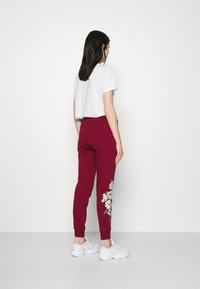 SIKSILK - FLORAL EMBROIDERED JOGGERS - Tracksuit bottoms - burgundy - 2