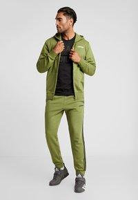 adidas Performance - ESSENTIALS SPORTS HOODED TRACK - Sweatjacke - tech olive - 1