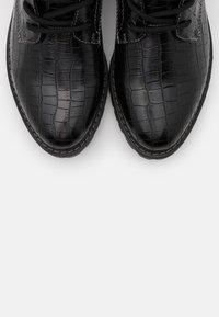 s.Oliver - Šněrovací kotníkové boty - black - 5
