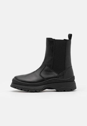PSSELIONE BOOT - Platform ankle boots - black